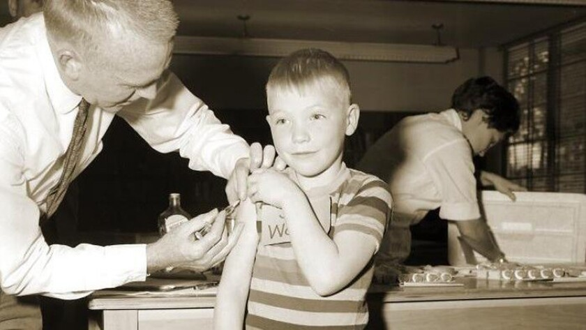 A doctor gives a measles vaccination to a boy at Fernbank School in Atlanta in 1962. A new analysis of historical data on measles incidence and deaths in the U.S., U.K. and Denmark suggests that measles may harm the immune system for years after it first strikes.