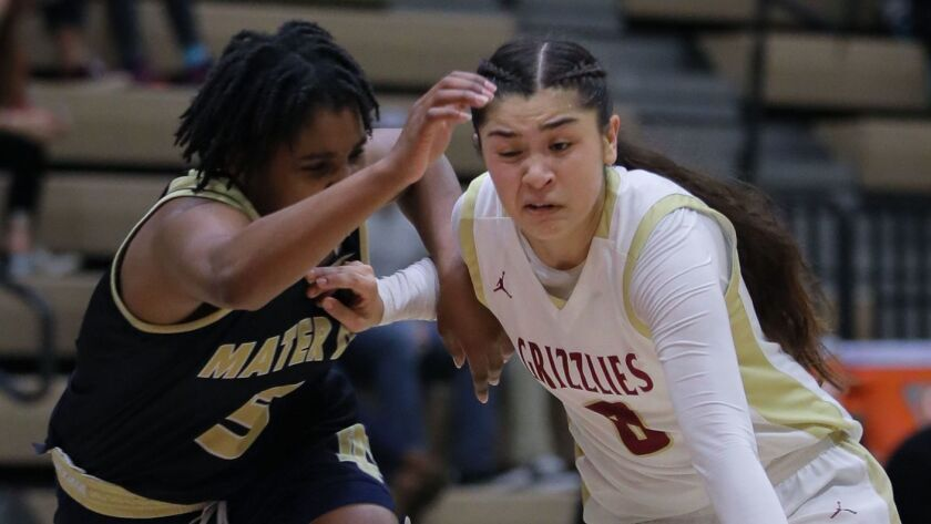 Auren Isaacson, of Mission Hills at right, tries to get past Chloe Webb, of Mater Dei.