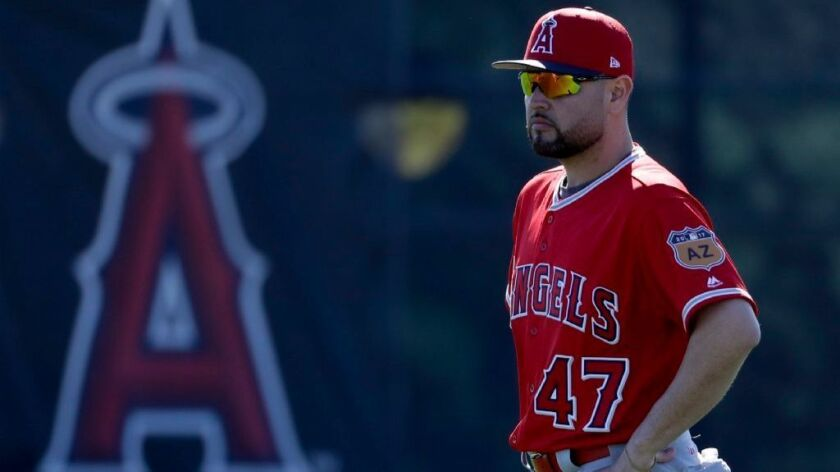 Angels starting pitcher Ricky Nolasco watches during spring training in Tempe, Ariz., on Feb. 15.