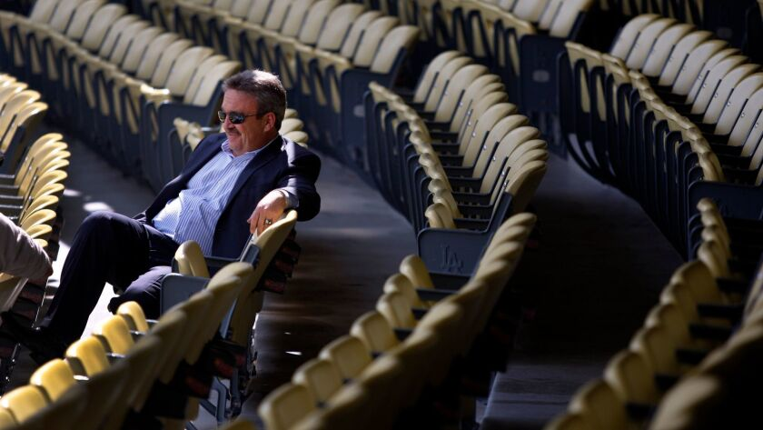 It can be tough at the top. Ned Colletti refects on his nine years as the Dodgers' general manager in his new memoir.