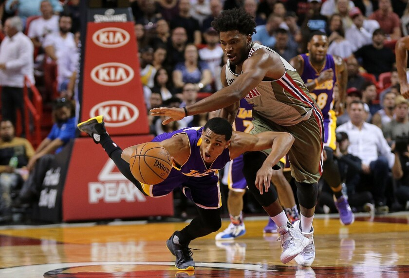 Lakers guard Jordan Clarkson and the Heat's Justise Winslow fight for a loose ball.