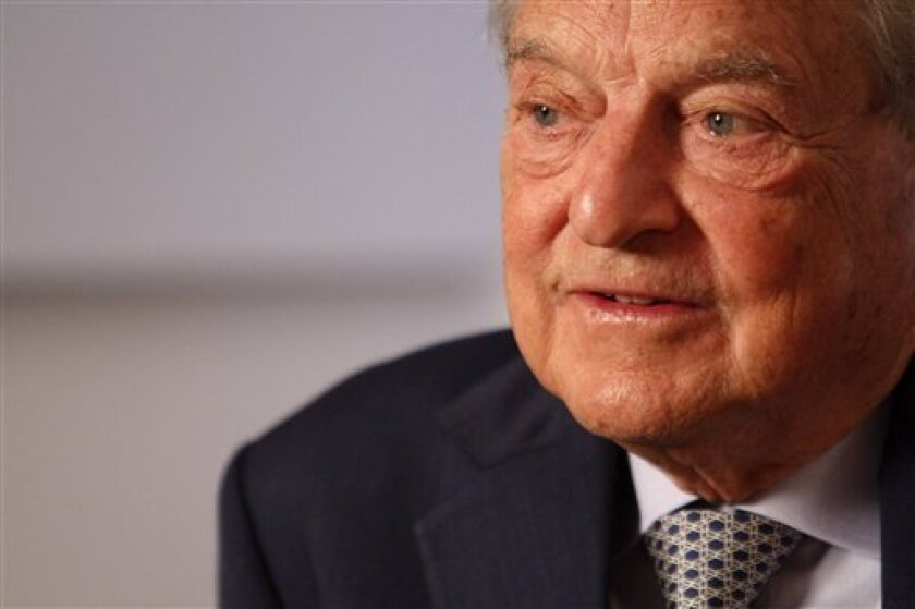 Philanthropist George Soros speaks during an interview with the Associated Press, Tuesday, Sept. 7, 2010, in New York. Soros has announced a 10-year, $100 million grant to Human Rights Watch. (AP Photo/Mary Altaffer)