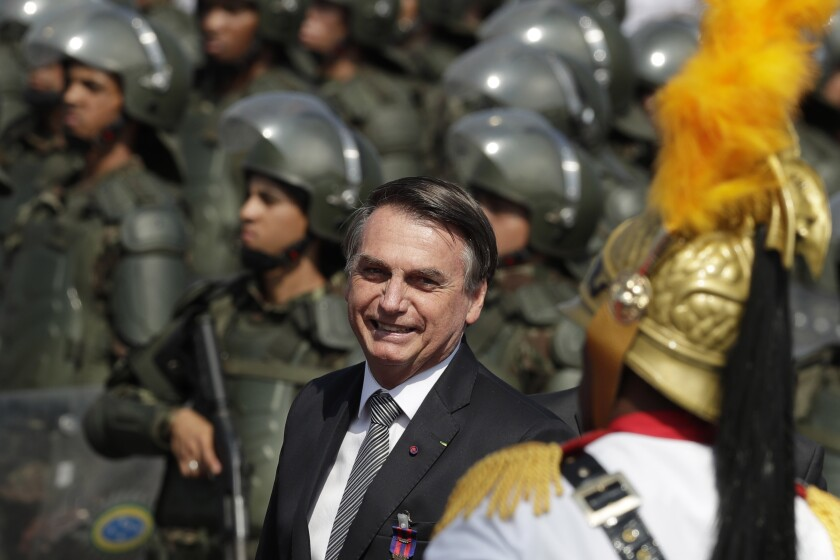 Brazil's President Jair Bolsonaro arrives at a military ceremony for the Day of the Soldier, at Army Headquarters in Brasilia, Brazil, on Friday.