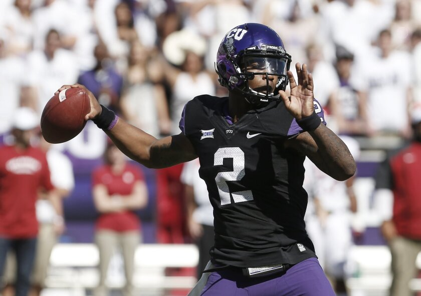 TCU quarterback Trevone Boykin (2) throws to an open teammate during the first half of an NCAA college football game against Oklahoma at Amon G. Carter Stadium, Saturday, Oct. 4, 2014, in Fort Worth, Texas. (AP Photo/Brandon Wade)