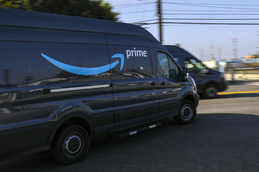 Delivery vans leave an Amazon warehouse in Hawthorne.