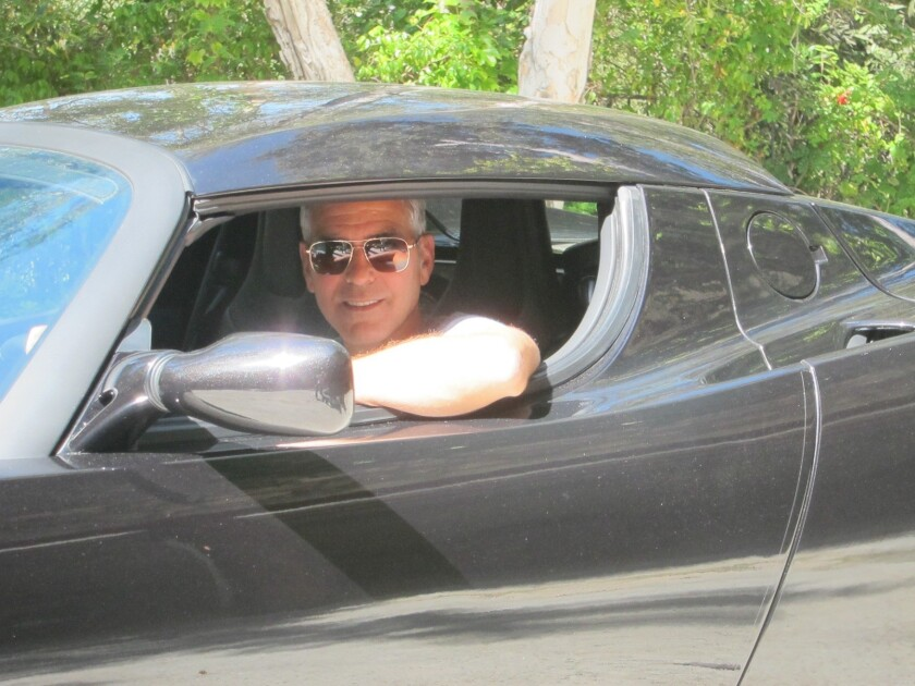 George Clooney plans to auction his Tesla Roadster electric sports car to raise money for a non-profit that monitors the borders of Sudan and South Sudan.