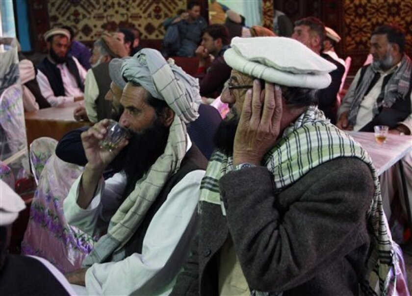 Afghan men gathered to watch television coverage announcing the killing of Al-Qaida leader Osama bin Laden a few minutes before the start of news service on a local TV channel at a local restaurant in Kabul, Afghanistan Monday, May 2, 2011. Bin Laden, the mastermind behind the Sept. 11, 2001, terro