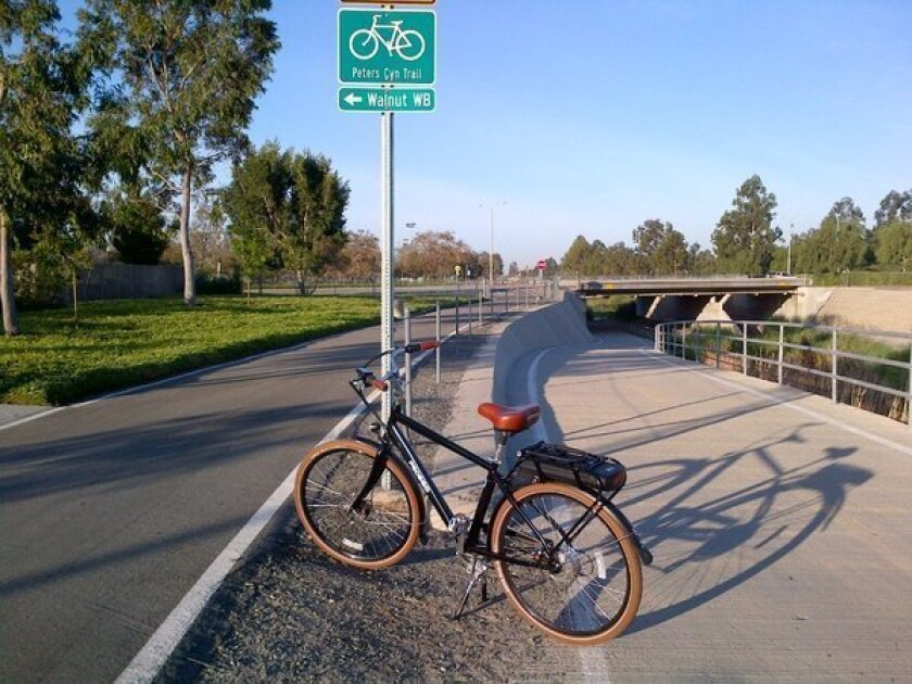 L.A. Times editor Peter Pae's Pedego City Commuter electric bicycle on a bike path in Irvine.