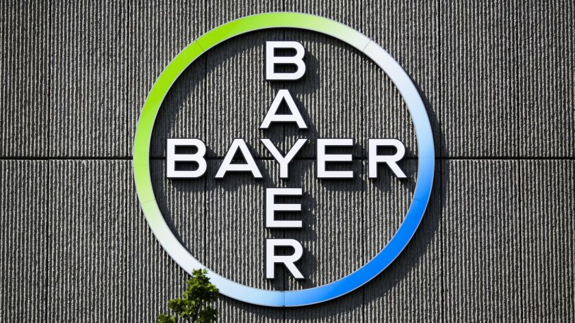 FILE - In this May 23, 2016 file picture the Bayer AG corporate logo is displayed on a building of t