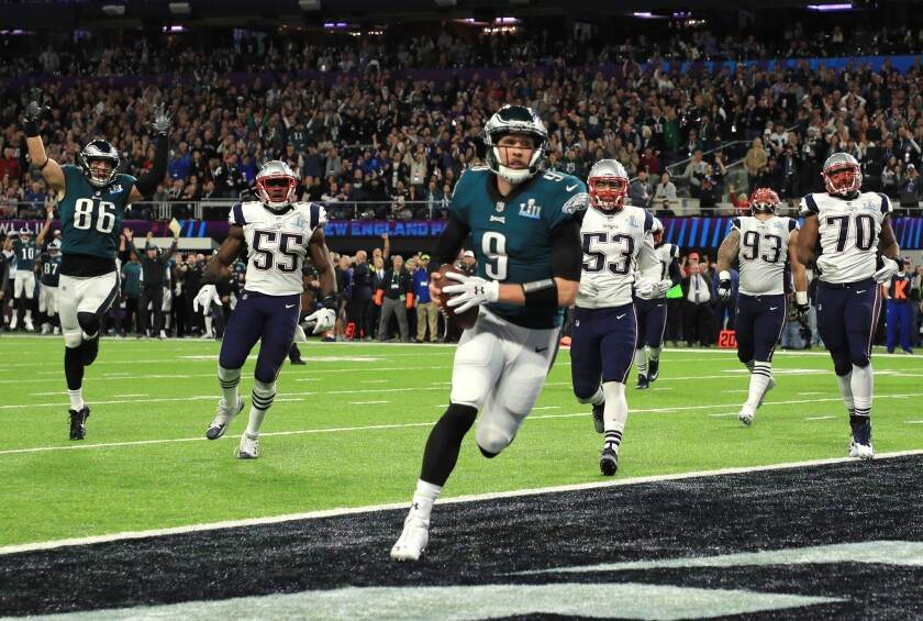 Eagles quarterback Nick Foles (9) catches a one-yard touchdown pass against the New England Patriots during the second quarter of Super Bowl LII.