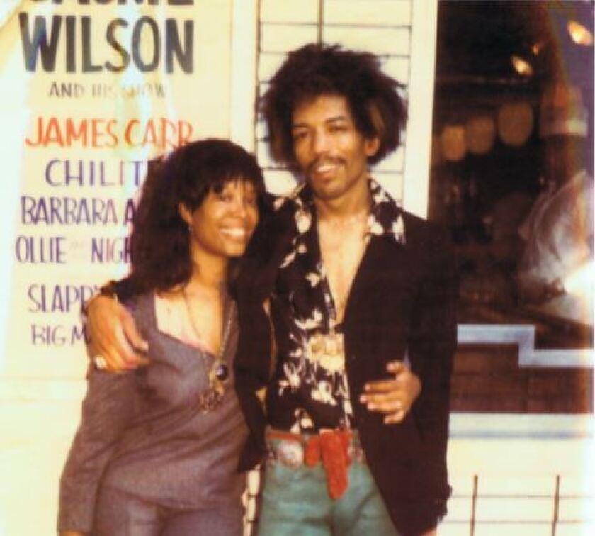 Lithofayne Pridgon and Jimi Hendrix outside the Apollo Theater in 1969.