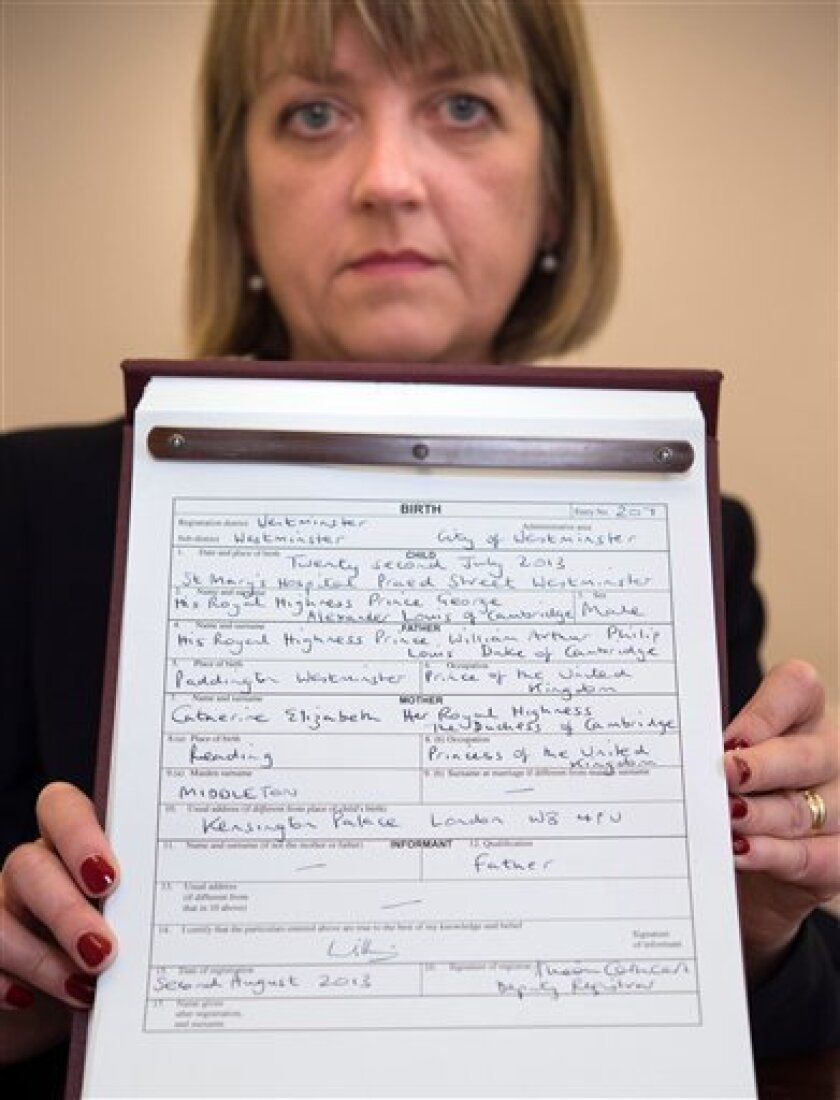 Westminster City Council registrar Alison Cathcart holds a copy of the birth register for Britain's Prince George of Cambridge, which was signed by his father, the Duke of Cambridge, at Kensington Palace in London on Friday, Aug. 2, 2013. The register gives the date and place of Prince George's birth and his full name as His Royal Highness Prince George Alexander Louis of Cambridge. (AP Photo / Stefan Rousseau/PA) UNITED KINGDOM OUT NO SALES NO ARCHIVE