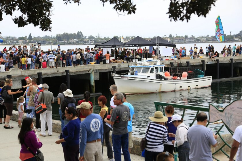 August 2nd, 2014 San Diego, CA- The first day of the Tuna Harbor Dockside Market near Seaport Village drew a crowd with some customers forming a line at 6am on Saturday morning. The response was larger than expected with some customers waiting two and a half hours to purchase fresh seafood. Photo b