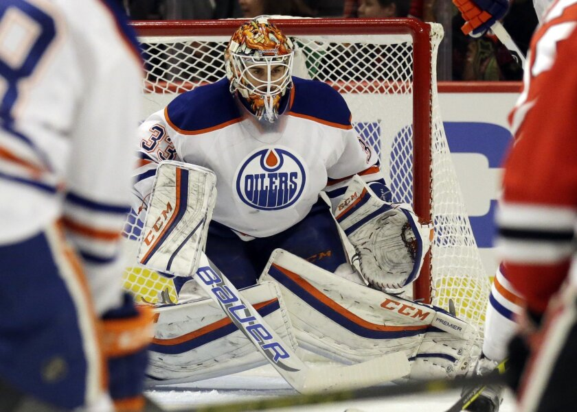 Edmonton Oilers goalie Cam Talbot watches the puck during the second period of an NHL hockey game against the Chicago Blackhawks, Sunday, Nov. 8, 2015,  in Chicago. (AP Photo/Nam Y. Huh)