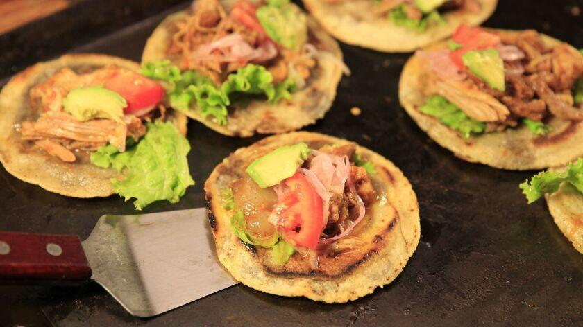 LOS ANGELES, CA.-AUG. 29, 2014: A detail of Panucho de Cochinita prepared by Chichen Itza Restaura