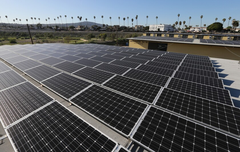 A large-scale solar panel project sits atop warehouses No. 9 and 10 at the Port of Los Angeles in San Pedro, which have been converted into retail space for shops and a microbrewery.