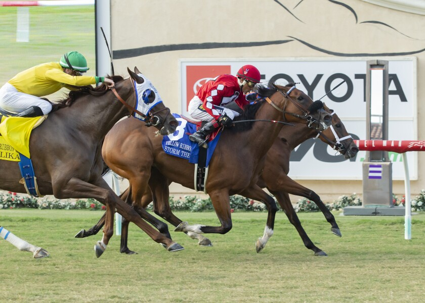 Beau Recall and jockey Drayden Van Dyke, inside, outleg Storm the Hill, outside, with Rafael Bejarano, and Vasilika, left, with Julien Leparoux, to win the Grade II, $200,000 Yellow Ribbon Handicap Saturday at Del Mar Thoroughbred Club.