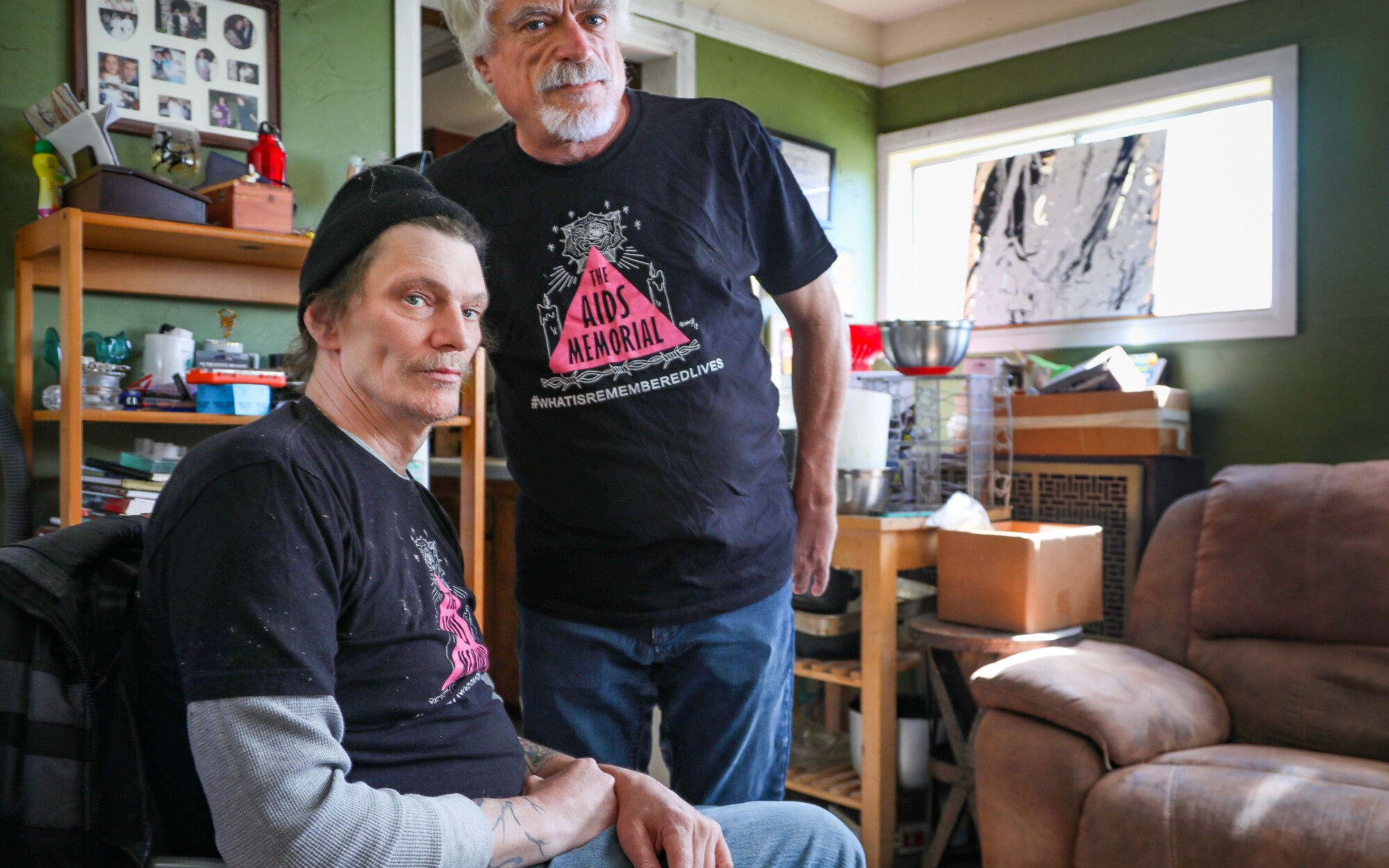 """Gary Graves, left, who has had AIDS for decades, and his partner and caregiver, Michael """"Mikie"""" Lochner, at their North Park home."""