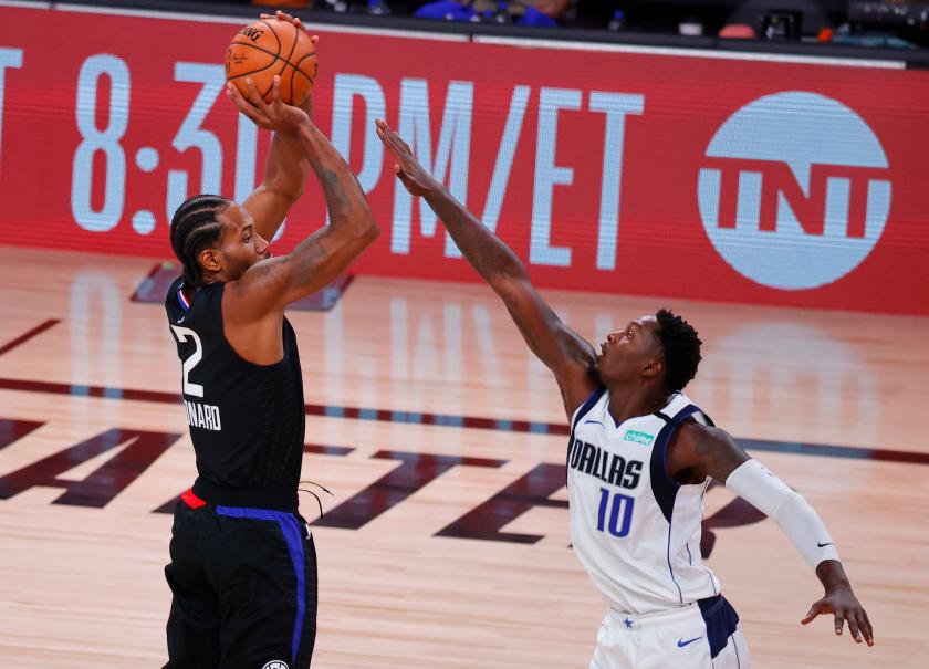 Clippers forward Kawhi Leonard shoots over Dallas Mavericks forward Dorian Finney-Smith.