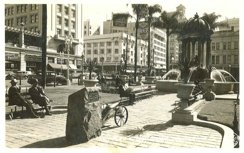Photo believed to be from 1930s of historic cannon on wheeled mount as it used to be in Horton Plaza.