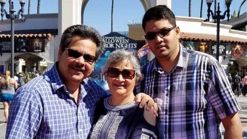 From left to right: Russell French, Paola French and their son, Kenneth French, at Universal Studios. Kenneth, 32, was shot and killed by an off-duty police officer in a Corona Costco on June 14.