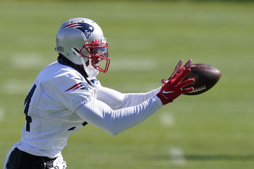 New England Patriots wide receiver Mohamed Sanu Sr. makes a catch during an NFL football training camp practice, Sunday, Aug. 30, 2020, in Foxborough, Mass. (AP Photo/Steven Senne, Pool)
