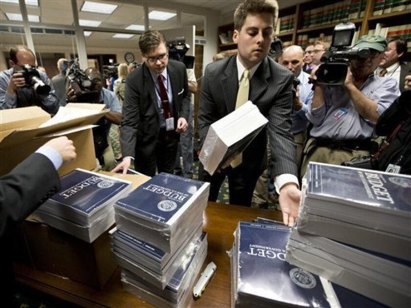 Copies of President Barack Obama's budget plan for fiscal year 2014 are distributed to Senate staff on Capitol Hill in Washington, Wednesday, April 10, 2013. The president sent Congress a $3.77 trillion spending blueprint that seeks to tame runaway deficits by raising taxes further on the wealthy a