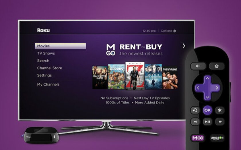 Roku unveiled new streaming video players and a partnership with movie and TV service M-Go.