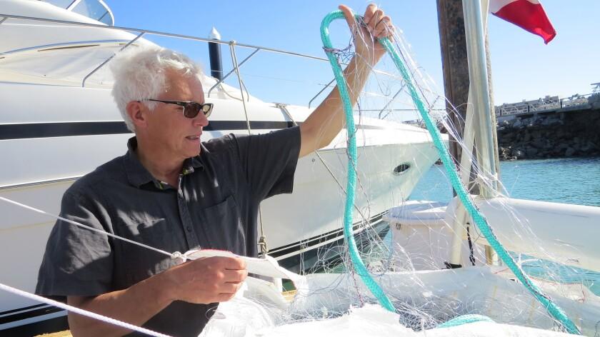 Mads Peter Heide-Jørgesen, a Danish biologist, shows a lightweight net that would be used to captur