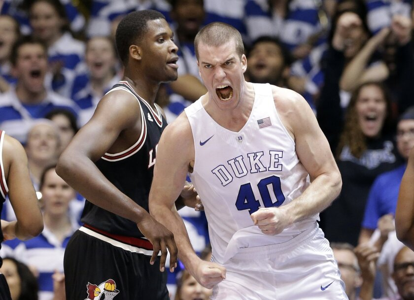 FILE - In this Feb. 8, 2016, file photo, Duke's Marshall Plumlee (40) reacts following a basket as Louisville's Jaylen Johnson looks on at left during the first half of an NCAA college basketball game in Durham, N.C. The end of an era is coming for Duke. Soon the Blue Devils will run out of Plumlees. (AP Photo/Gerry Broome, File)
