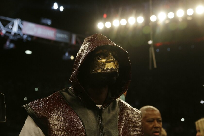 Deontay Wilder enters the ring during the WBC heavyweight boxing match against Eric Molina, Saturday, June 13, 2015, in Birmingham, Ala. (AP Photo/Brynn Anderson)