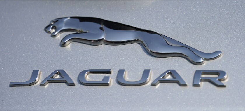 FILE - In this file photo dated Sunday, Sept. 6, 2020, the Jaguar car company logo shines off the deck of an I-Pace electric vehicle at a Jaguar dealership, in Littleton, USA. Struggling luxury car brand Jaguar will be fully electric by 2025, the British company said Monday Feb. 15, 2021, as it outlined a plan to phase out internal combustion engines.(AP Photo/David Zalubowski, FILE)