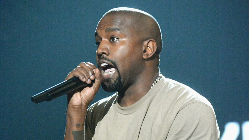 Kanye West accepts the Video Vanguard Award onstage during the 2015 MTV Video Music Awards.