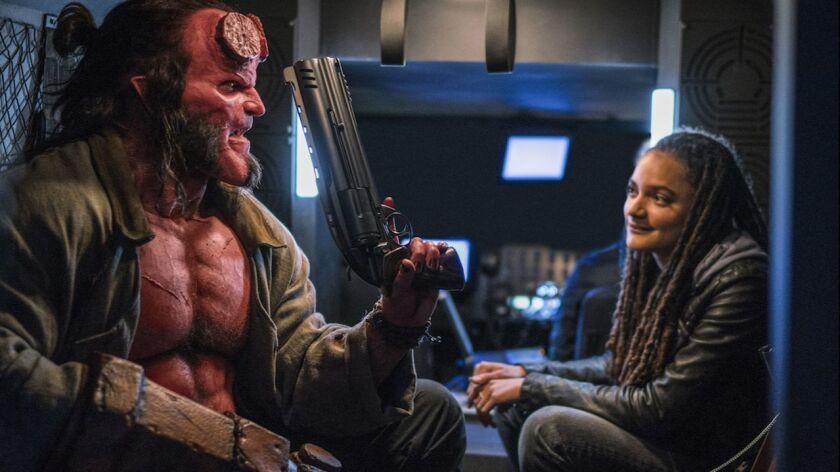 "David Harbour and Sasha Lane in the movie ""Hellboy."""