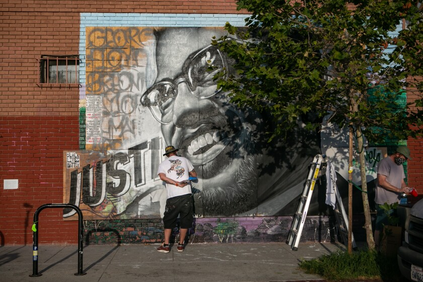 Tristan Eaton paints a mural of Malcolm X