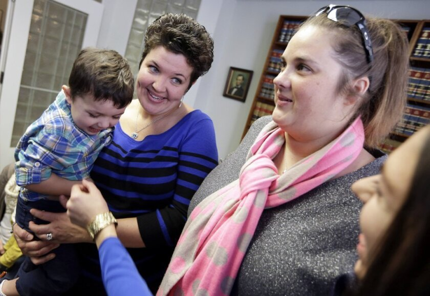 Nicole, left, and Pam Yorksmith are among four legally married gay couples who filed a federal civil rights lawsuit Monday seeking a court order to force Ohio to recognize same-sex marriages on birth certificates despite a statewide ban.