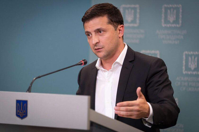 FILE - In this Tuesday, Oct. 1, 2019 file photo, Ukrainian President Volodymyr Zelenskiy speaks to media during his press conference in Kyiv, Ukraine. Ukraine's president appears to be playing to both sides of the U.S. political divide, hedging his bets to ensure U.S. financial and military aid keeps flowing no matter who wins next year's election. (Ukrainian Presidential Press Office via AP, File)