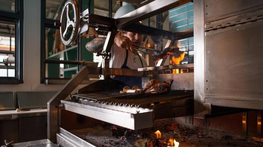 "Campfire restaurant in Carlsbad features a 12-foot hearth named ""Grace"" where many dishes are cooked over an open fire. (Courtesy photo)"