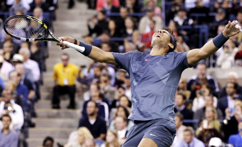 Rafael Nadal reacts after winning the final point in a four-set victory over Novak Djokovic in the men's championship match at the U.S. Open.