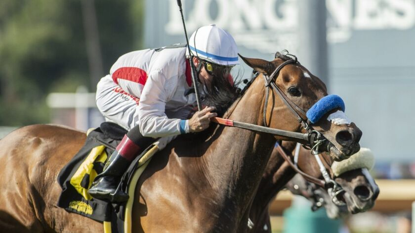In this image provided by Benoit Photo, Elysea's World, with Drayden Van Dyke aboard, wins the Grade