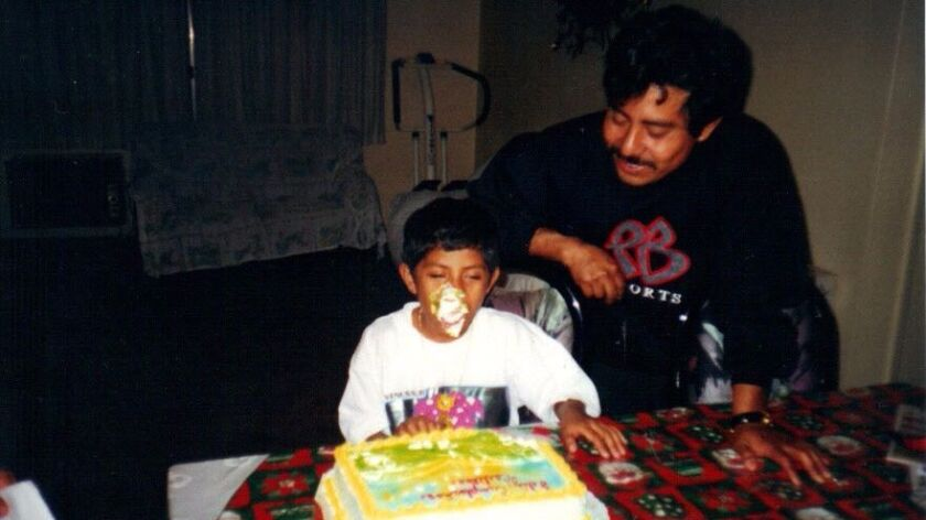 Carlos Paz Martinez celebrates his 8th birthday with his father, Carlos Paz Sr.