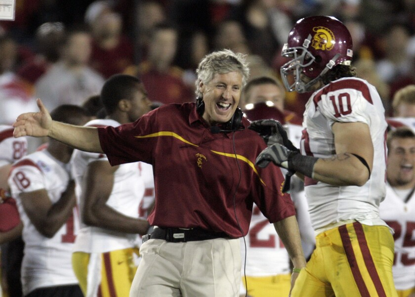 Then-USC Coach Pete Carroll and Brian Cushing celebrate toward the end of the Trojans' 32-18 victory over Michigan in the Jan. 1, 2007 Rose Bowl.
