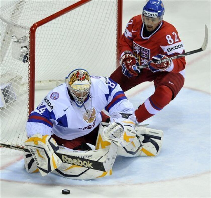 Tomas Plekanec, right, of the Czech Republic looks at the Russian goalkeeper Konstantin Barulin, left, during their qualification round group E Hockey World Championships match  in Bratislava, Slovakia, Sunday, May 8, 2011. (AP Photo/CTK, Jan Koller)  *