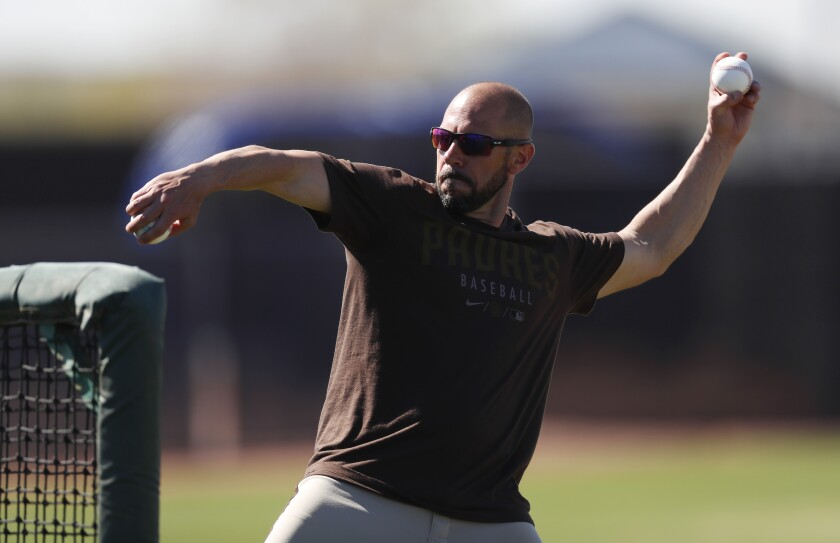 Padres manager Jayce Tingler throws batting practice during spring training.