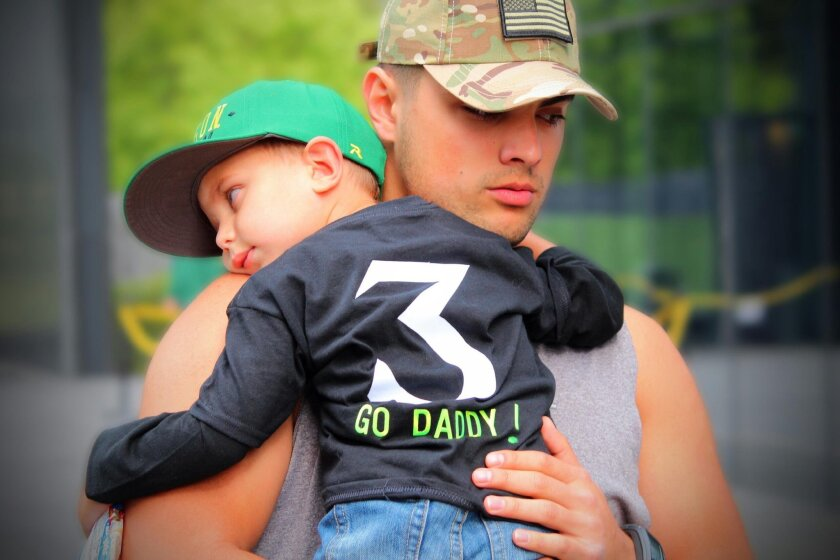 New SDSU quarterback Jake Rodrigues became a father at the age of 16. It was a stressful time, but he says his son, Brody, 3, is the light of his life.