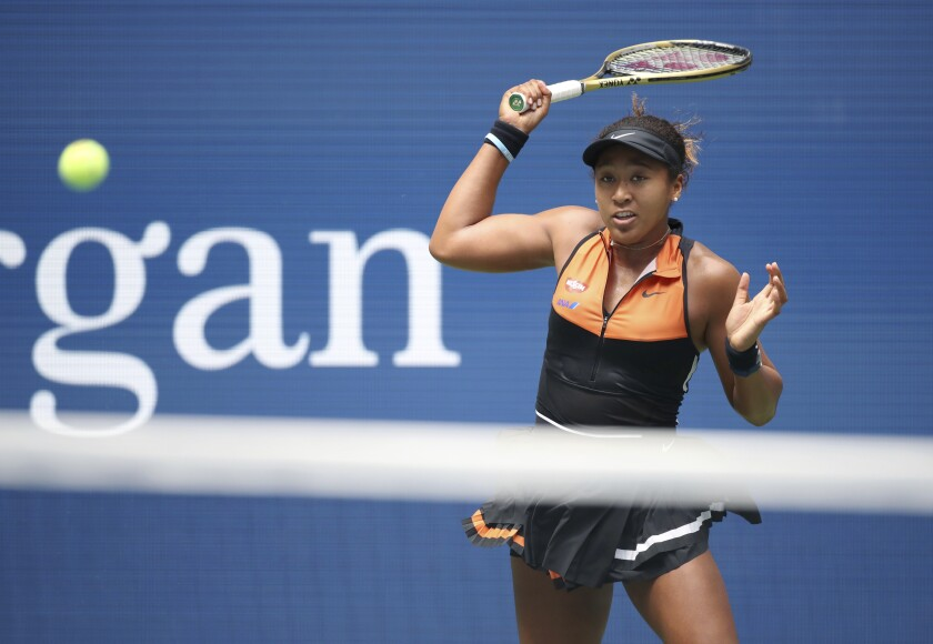 Naomi Osaka returns a shot during her first-round victory over Anna Blinkova at the U.S. Open on Tuesday.