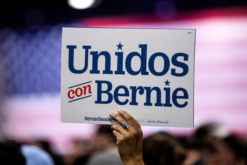 A supporter holds a poster during a campaign rally for US Democratic presidential candidate Senator Bernie Sanders at the Los Angeles Convention Center in Los Angeles, USA, 01 March 2020. EFE/EPA/Etienne Laurent