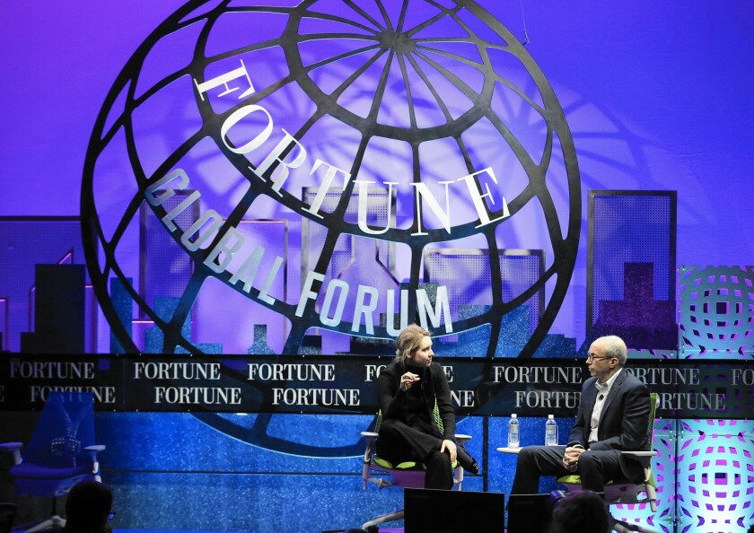 Theranos is losing business deals, according to a recent report. Above, Elizabeth Holmes, founder and chief executive of Theranos, left, speaks at the Fortune Global Forum in San Francisco last month.