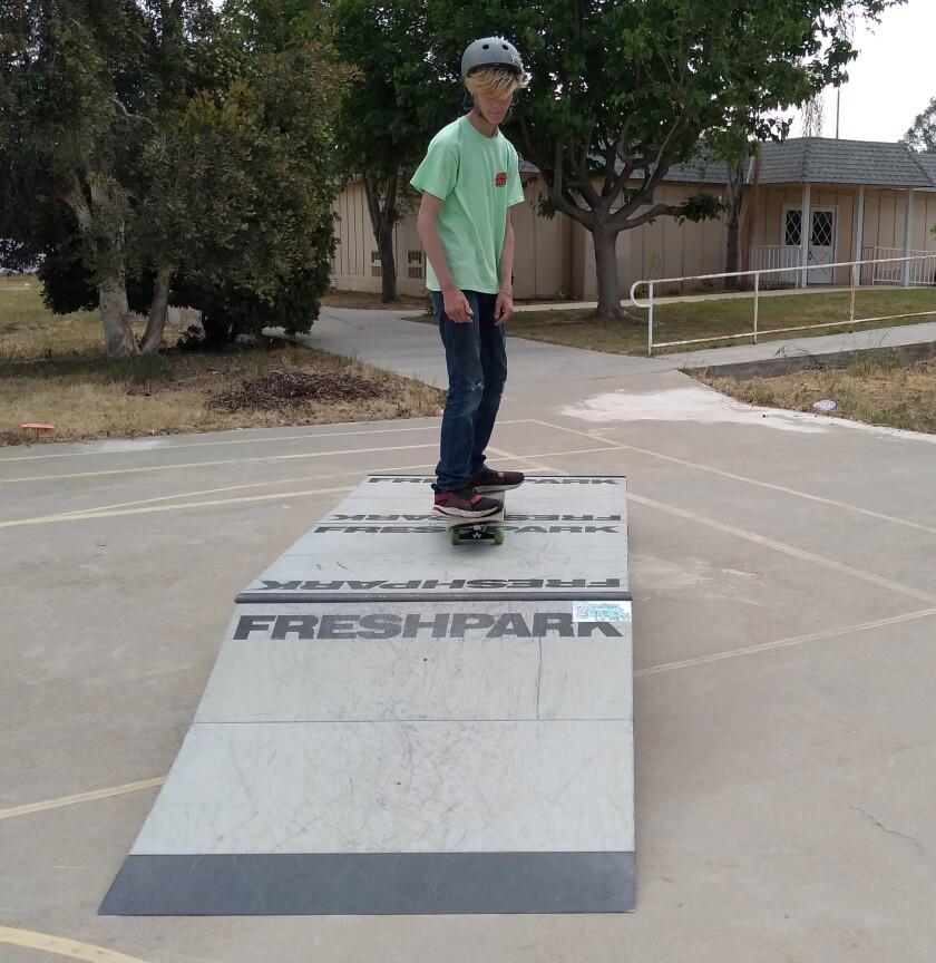 Mountain Valley Academy eighth-grader Nathan Deming, 14, rides a ramp at the Ramona Skatepark Champions' pop-up skatepark.