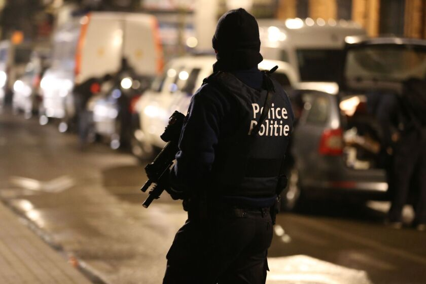 Police officers take part in an operation in Brussels after a deadly terrorist attack in late March.